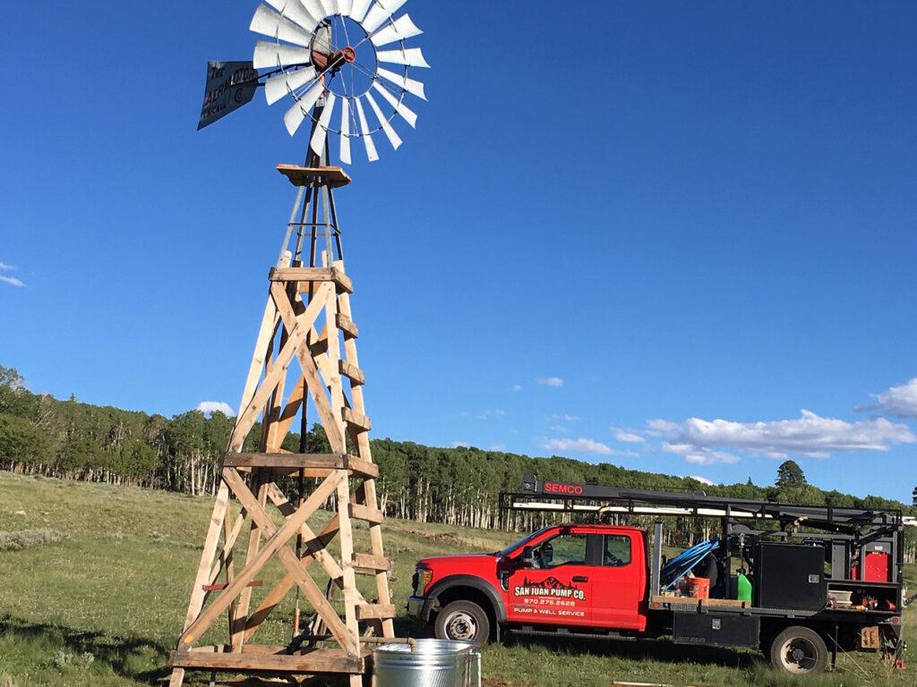 San Juan Pump work truck near windmill
